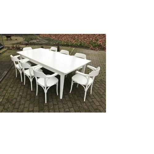 Hardhouten witte eettafel met bijbehorende stoelen.  afbeelding