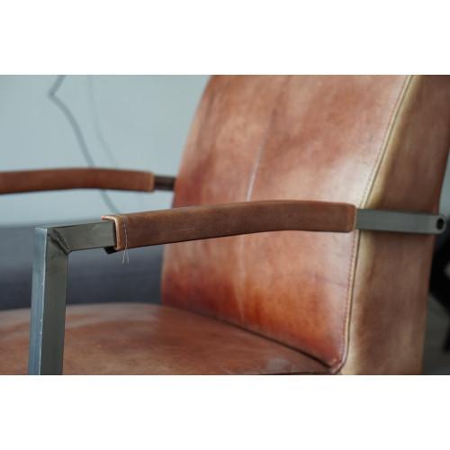 Leren custom made stalen frame stoelen op wielen afbeelding